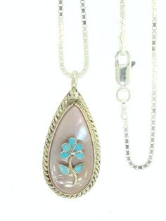 By Zuni Artist Rodney Lasiloo:Beautiful! Sterling-silver Navajo Tree of Life Turquoise/Mother of Pearl Pendant-necklaces(18 inches) Rich Peel,http://www.amazon.com/dp/B000RDL07C/ref=cm_sw_r_pi_dp_cDQ5sb0V584Q8J7Z