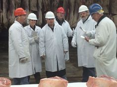https://flic.kr/p/CvwQ1t | Meat graders discussing the meat in front of them | Here at AMS, one of the many benefits of creating marketing opportunities for ag businesses is seeing first-hand how the industry supports 1 in 12 jobs all over the country.