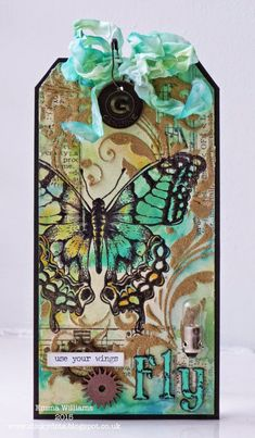 Love this Tim Holtz inspired tag by http://stickydots.blogspot.com!  It is just beautiful to look at!