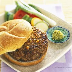 Peanutty Crunch Burgers. Made with half ground turkey and half ground beef, these peanut topped burgers take America's favorite sandwich in delicious new direction.