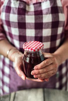 Stock photo of Hand holding jar filled with homemade strawberry jam by pixelstories Plum Room, Easy Chicken Enchilada Casserole, Beautiful Home Gardens, House Beautiful, Roasted Tomato Sauce, Homemade Strawberry Jam, Sunday Riley, Plum Tree, Jam And Jelly
