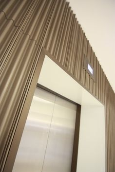 Harcourt London- 110 Cannon st, corrugated leather walls for Morey Smith architects.