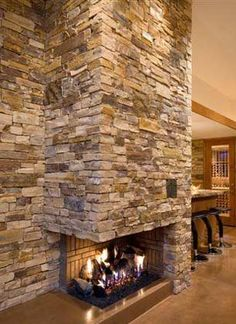 We have a corner fireplace.  I could put stone around it like this.