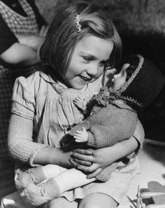 dollmixture:  Diana Burl, born during the Blitz, cuddles a doll, one of the gifts distributed through Hoxton Market Mission, London 1946.
