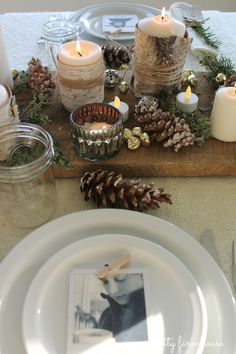 City Farmhouse- Photo ornaments...love the wooden tray with mercury glass votives....and the twine wrapped around the birch bark candles and the smattering of jingle bells