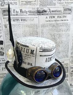 Available on etsy.com/shop/arcaniumdesign : Steampunk Mini Top Hat Fascinator - Newsprint with Tiny Goggles and Embellishments