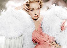Marlene Dietrich wears Christian Dior.