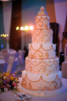 Gold Wedding Cakes Five tier gold cake. Indian Cake, Indian Wedding Cakes, Arab Wedding, Gold Wedding, Indian Weddings, Purple Wedding, Wedding Decor, Pretty Cakes, Beautiful Cakes