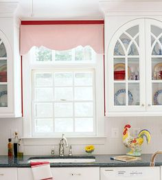 Classic Boxed Cornice I tink that is cute in pink and I like the glass cabinet doors:)