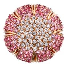 DAMIANI | Beautiful sunburst design, with diamonds and pink sapphires, graduated in color from light to intense pink and set in 18K yellow gold. In total, .87 carats of diamonds and 7.02 carats of sapphires harmonize to create this brilliant design. | {đιåмσиđѕ&ρєåɾℓѕ}