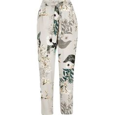 River Island Grey floral tie waist tapered trousers ($47) ❤ liked on Polyvore featuring pants, trousers, tie belt, floral print trousers, tie waist belt, peg-leg pants and grey pants
