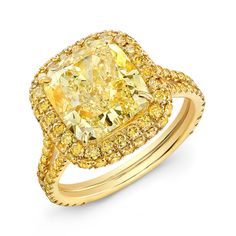 5.36 ct. natural fancy yellow cushion-cut diamond and 1.11 cts. t.w. natural yellow diamond pavé by Norman Silverman