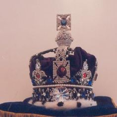 The Imperial State Crown is the best known and probably the most magnificent of all the Royal Regalia. Made in 1838 for the coronation of Queen Victoria. This crown was later modified for the coronations of King George in 1937 and Queen Elizabeth in 1953. This crown is worn upon leaving Westminster Abbey, at great state occasions, and at the state opening of Parliament.