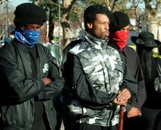 New Black Panther leader General Taco (middle) flanked by two members of the NBPP | New Black Panther leader: Hunt down and kill white people.