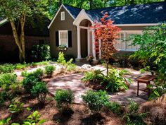 After: With a beautiful shade tree at the center and shrubs around the perimeter, this area has become a welcoming sitting space.
