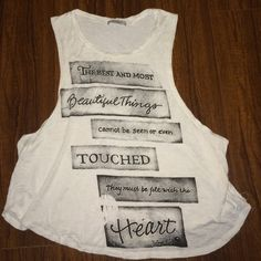 """Awesome quote tank top White soft tank cut low on the sides with """"The best and most beautiful things cannot be seen or even touched.... They must be felt with the heart"""" quote! so true and so cute! Size tags cut out but it can fit size small- med Tops Tank Tops"""