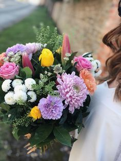 The beautiful blush pastel pinks and gorgeous greens in this wonderful hand-tied bouquet are simply stunning. With gerbera, chrysanthemum, and roses, this bouquet will make anyone's day perfect!