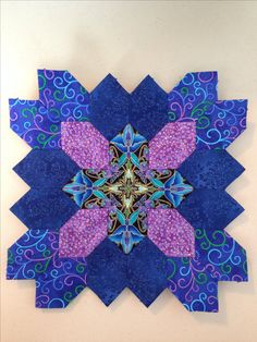 Lucy Boston (POTC/Patchwork of the Crosses) quilt block made with English paper piecing.