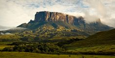 Mount Roraima in Venezuela, Brazil, and Guyana | The incredible tabletop mountains are some of the oldest geological formations on the planet, dating back about 2 billion years ago. This was also part of the inspiration for Paradise Falls in Disney's UP.
