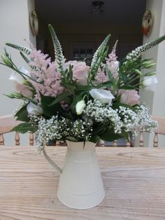 Home designed vintage wedding table decoration including blush pink roses, astilbe, veronica and gypsophila.