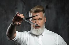 men using beard scissors