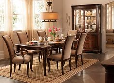 The best part about this Keira 7-piece dining set is that it seamlessly blends classic details with modern style. The cabriole legs are reminiscent of 19th-century furniture, while the sleek, curvy chairs upholstered in tweed chenille provide a little contemporary flavor.