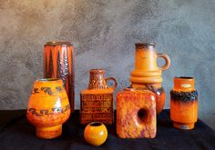 Bay vase, third from left, decor Remini by Bodo Mans,   Hole vase...alway wanted one of these and to find one in orange.