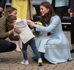 Catherine, Duchess of Cambridge receives flowers from a boy at Place Clairefontaine during a one day visit to Luxembourg on May 11, 2017 in Luxembourg, Luxembourg.