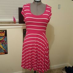 Old Navy Knit Dress Stretch knit dress from Old Navy. Bright pink (not hot pink) with white stripes in multiple directions. Knee length with cap sleeves.   Size Large but fits up to an XL Old Navy Dresses