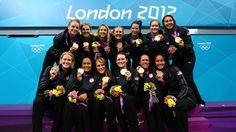 Gold medallists ~ The United States pose on the podium following the medal ceremony for the Women's Water Polo on Day 13 of the London 2012 Olympic Games at the Water Polo Arena