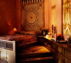 Moroccan style headboard and steps leading to the bed add a sacred presence to this bedroom interior.