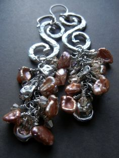 Swirls of sterling with keishi pearls and Swarovski crystal.