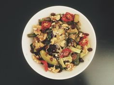 Noodles with vegetables (zucchini, asparagus, green pepper and dried tomato) nuts, sesame seeds and parmesan cheese. @sther_re