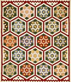 """Garden Mosaic: This intricate flower bed is composed of more than 3,000 hexagons! Paper-piecing ensures uniform seams as you hand-stitch the flower units and join them with a red-and-white garden path. Designer: Martha Skelton. Finished quilt: 88×103"""". Finished side of hexagon: 1""""."""