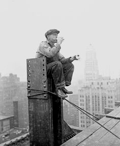 A construction worker takes a break atop the frame of the One LaSalle Street building in 1929. Photograph from the Chicago Daily News. DN-0089665