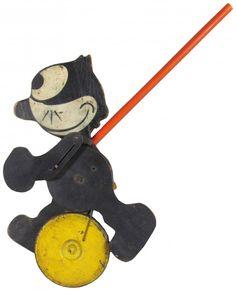 Vintage Felix the Cat Die Cut Wood Toy Walker. Magical Felix is 13.5 in. via live auctioneers