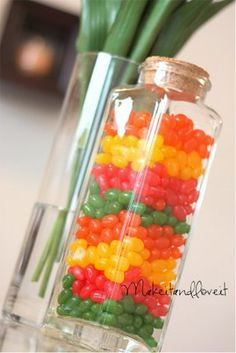 Jelly Bean Jar Decor. This is so pretty and cheery. It would look so great around Easter. And you can eat it once you're done!