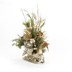 A custom silver sleigh decorated with a handcrafted christmas floral arrangement Christmas Flower Arrangements, Indoor Christmas Decorations, Christmas Flowers, Christmas Centerpieces, Floral Arrangements, Christmas Porch, Silver Christmas, Christmas Design, Christmas Wreaths