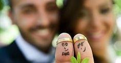 """close up of """"thumb puppets"""" with wedding bands--after ceremony"""