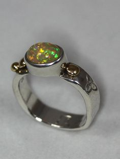 Hey, I found this really awesome Etsy listing at https://www.etsy.com/listing/606340195/floating-welo-opal-ring-set-in-sterling