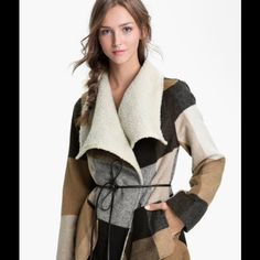 Jolt Plaid Coat Very cute coat with tan/brown/black colors with front and side pockets. Belt is missing but can easily be replace by any black belt or wear just opened up.                90% Polyester 10% wool  and Lining 100% Polyester. Jolt Jackets & Coats