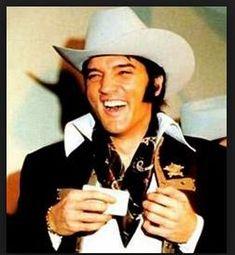 Elvis Presley receives a membership card & Texas cowboy hat prior to his performance - Houston Stock Show & Rodeo - Astrodome - Houston, february 27 1970