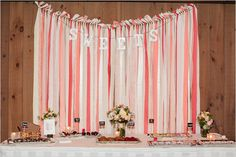 fabric streamer sweets table backdrop