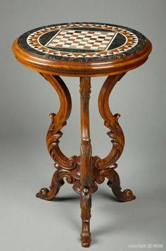 A top marble inlaid tripod table