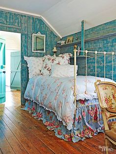 Bundles of bouquets bloom across this bedding in a nod to English cottage style's love of floral prints. Just one of many ways to bring the glory of a country garden inside, these blossoms last much longer than cut flowers! Popular, too, are planked walls and painted pieces. These heavily distressed blue walls check both boxes./