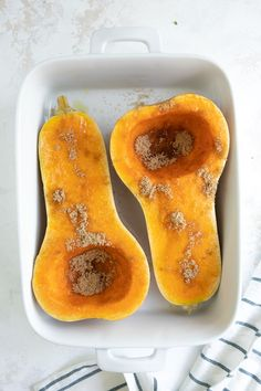 Butternut squash in baking pan sprinkled with brown sugar
