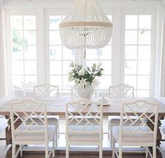 White-Theme Dining Room | Ballard designs Dayna chairs. Ro Sham beaux chandelier, beaded chandelier, coastal style , hamptons style , restoration hardware, White French doors. #tallahasseedining #diningrooms