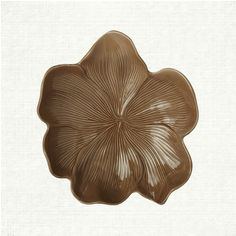 View the Medium Taupe Magnolia Plate from Arhaus. Known as the aristocrats of the plant world, the majestic Magnolia is celebrated for its profusion