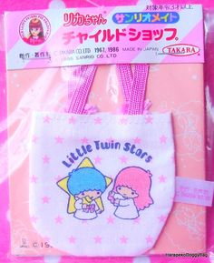 A vintage Sanrio / Takara miniature dollhouse toy. The mini Little Twin Stars carry bag comes from a series of Licca Chan Dress Shop toy miniatures for doll houses. The kawaii Japanese fancy good item was made in 1986 in Japan.