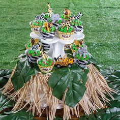 The DIY Safari Cupcake Tree will turn a boring cupcake stand into one for your safari themed party.